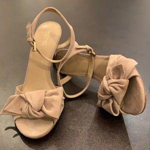Michael Kors sueded bow heel.